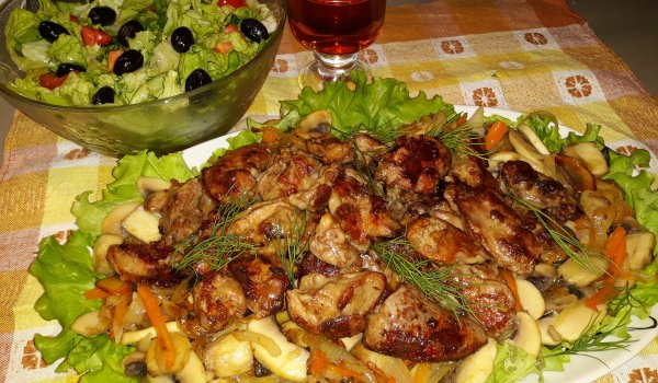 Chicken Livers in a Pan with Onions, Carrots and Mushrooms