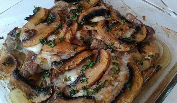 Pork Steaks with Mushrooms and Processed Cheese in Glass Cooking Tray