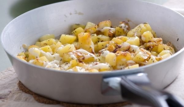 Potatoes with Cheese in a Pan
