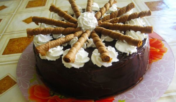 Cake with Chocolate Mousse and Wafer Rolls